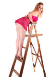Pretty girl on the stepladder. Royalty Free Stock Image