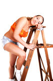 Pretty girl on the stepladder. Royalty Free Stock Photography