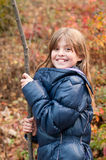 Pretty girl with stick Stock Image