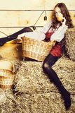 Pretty girl on straw bales royalty free stock photos