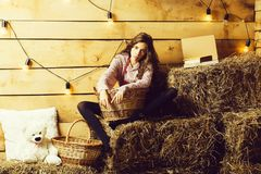 Pretty girl on straw bales stock images