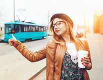 Pretty girl in the street with coffee Royalty Free Stock Photos