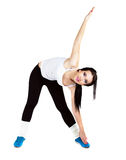 Pretty girl stretching muscles. Touching hand foot. White Background Stock Image