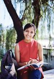 Pretty girl studying in campus. Royalty Free Stock Photo