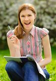 Pretty girl studying outdoors Royalty Free Stock Images