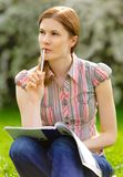 Pretty girl studying outdoors Stock Photo