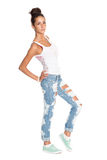 Pretty girl in stylish ripped jeans Stock Images