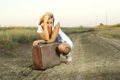 Pretty girl with a suitcase Royalty Free Stock Photo