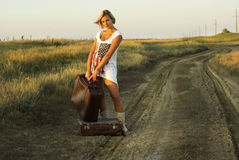 Pretty girl with a suitcase Royalty Free Stock Photos