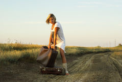 Pretty girl with a suitcase Stock Image