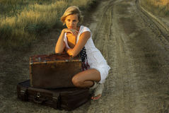 Pretty girl with a suitcase Stock Photos