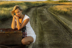 Pretty girl with a suitcase Royalty Free Stock Image