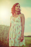 Pretty girl in a summer field Royalty Free Stock Photography