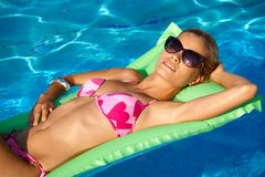 Pretty girl at summer in pool Royalty Free Stock Images