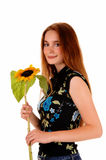 Pretty girl with sunflower. Royalty Free Stock Image
