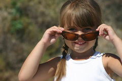 Pretty Girl with sunglasses. A young cute girl wearing sunglasses royalty free stock photo