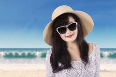 Pretty girl with sunglasses at coast Royalty Free Stock Image