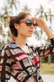 Pretty girl in sunglasses posing to the camera. Royalty Free Stock Images
