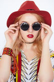 Pretty girl with sunglasses and red hat Royalty Free Stock Photography