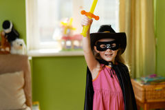 Pretty girl in a superhero suit Stock Photo