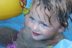 Pretty girl swimming Stock Photo