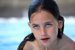 Pretty girl swimming royalty free stock photo