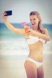 Pretty girl in swimsuit taking a selfie Stock Image