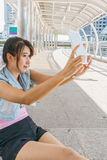 Pretty girl taken pictures of her self. With tablet Stock Photography