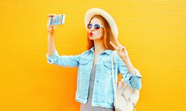 Pretty girl takes a picture self portrait on a smartphone Royalty Free Stock Photo