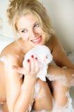 Pretty girl taking a bath stock photo