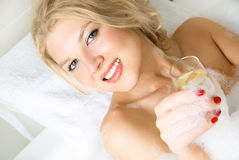 Pretty girl taking a bath Stock Image