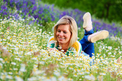 Pretty girl taking a garden of flowers. Stock Photography