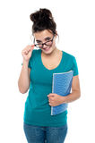 Pretty girl taking off her glasses Stock Photography