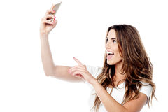 Pretty girl taking a picture of herself Royalty Free Stock Images