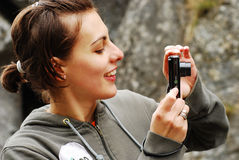 Pretty girl taking pictures Royalty Free Stock Photos