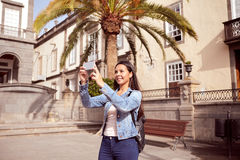 Pretty girl taking pictures with cell phone Royalty Free Stock Photos