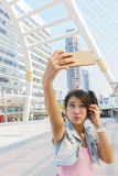 Pretty girl taking a selfie. With smartphone Stock Image