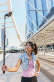 Pretty girl taking a selfie. Young beautiful woman taking a selfie in the city Stock Photos