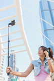 Pretty girl taking a selfie. Young beautiful woman taking a selfie in the city Royalty Free Stock Photos
