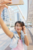 Pretty girl taking a selfie. Selfie pretty young woman taking a picture in the city Royalty Free Stock Photography