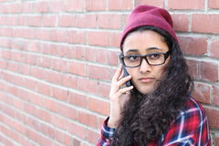 Pretty girl talking on the cell phone Stock Photos