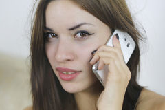Pretty girl talking with her mobile phone Royalty Free Stock Images