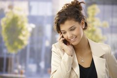 Pretty girl talking on mobile outdoors Royalty Free Stock Photography