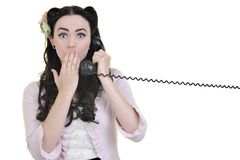 Pretty girl talking on old phone Royalty Free Stock Image