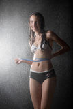 Pretty girl with tape measure in water studio Stock Image
