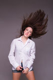 Pretty girl teenager jumping at studio expressing happiness Royalty Free Stock Image