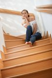 Pretty girl thinking at staircase Royalty Free Stock Image