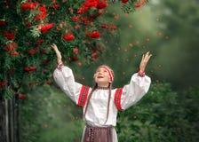 A pretty girl throws up Rowan berries