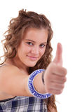 Pretty girl with thumb raised as a sign of success Stock Photo