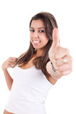 Pretty girl with thumb raised as a sign of success Stock Image